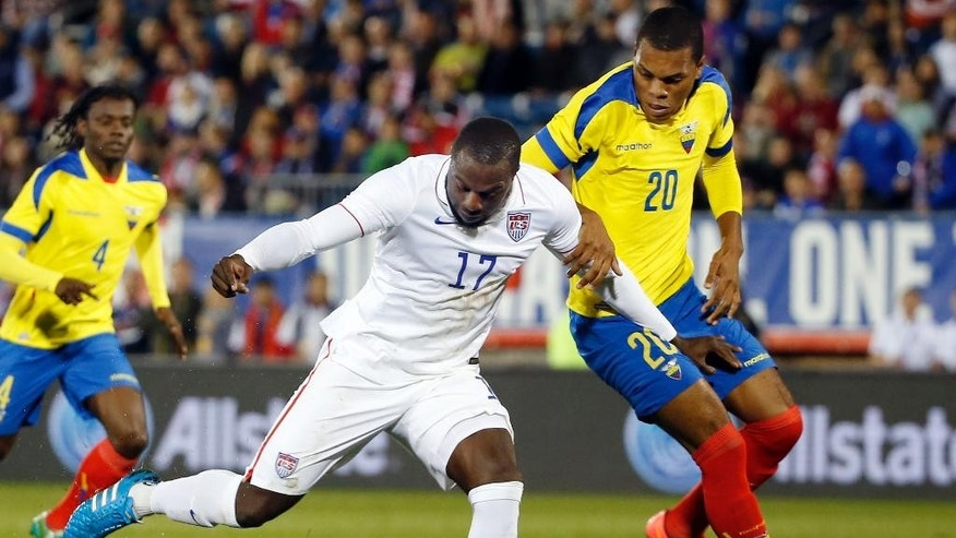 In this Oct. 10, 2014 photo, United States' Jozy Altidore (17) shoots against the defense of Ecuador's Luis Canga (20) during an exhibition soccer match in East Hartford, Conn. Following the fortunes of U.S. players on top clubs in Europe's best leagues doesn't take much time these days. Except for the goalkeepers, most of the Americans in the most competitive first divisions are struggling for playing time. (AP Photo/Elise Amendola, file)