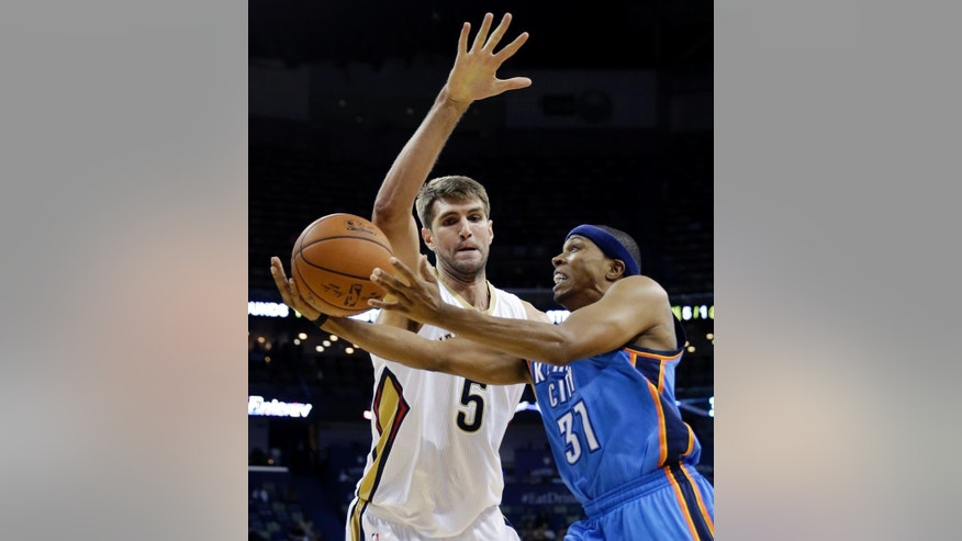 Oklahoma City Thunder guard Sebastian Telfair (31) drives to the basket against New Orleans Pelicans center Jeff Withey (5) in the first half of an NBA preseason basketball game in New Orleans, Thursday, Oct. 16, 2014. (AP Photo/Gerald Herbert)
