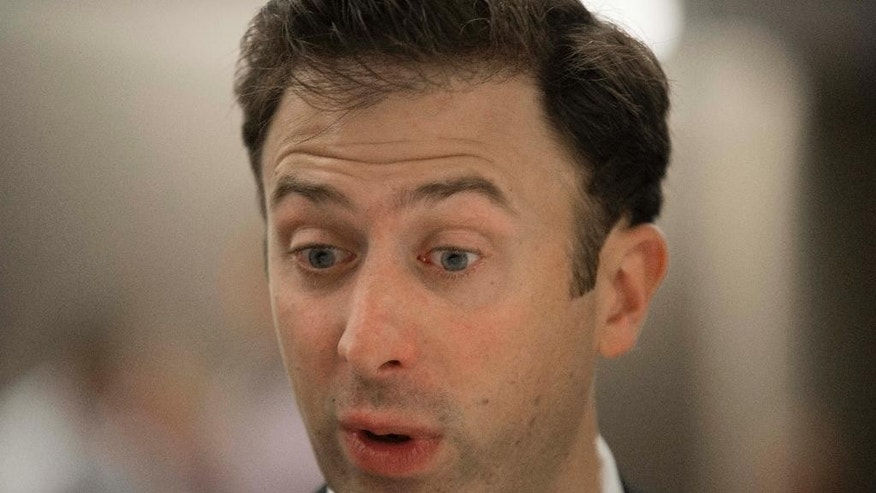 Minnesota men's head coach Richard Pitino talks with reporters during a Big Ten NCAA college basketball media day in Rosemont, Ill., Thursday, Oct. 16, 2014. (AP Photo/Paul Beaty)