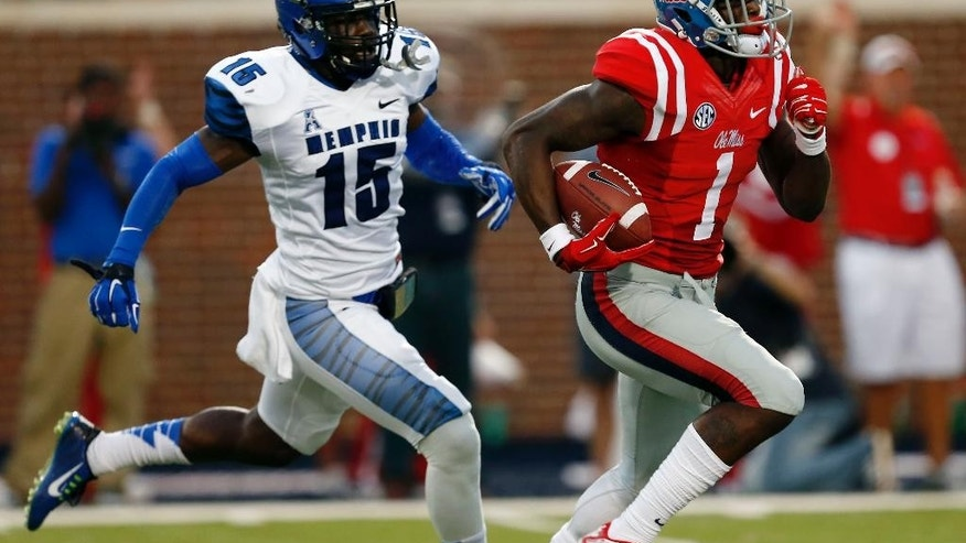 FILE - In this Sept. 27, 2014, file photo, Mississippi wide receiver Laquon Treadwell (1) runs past Memphis defensive back Fritz Etienne (15) for a 63-yard touchdown reception in the first half of an NCAA college football game  in Oxford, Miss. The Rebels have rocketed from an SEC afterthought to the No. 3 team in the country by bringing in better talent, starting with a talented sophomore class that includes Robert Nkemdiche, Treadwell and Laremy Tunsil. (AP Photo/Rogelio V. Solis)