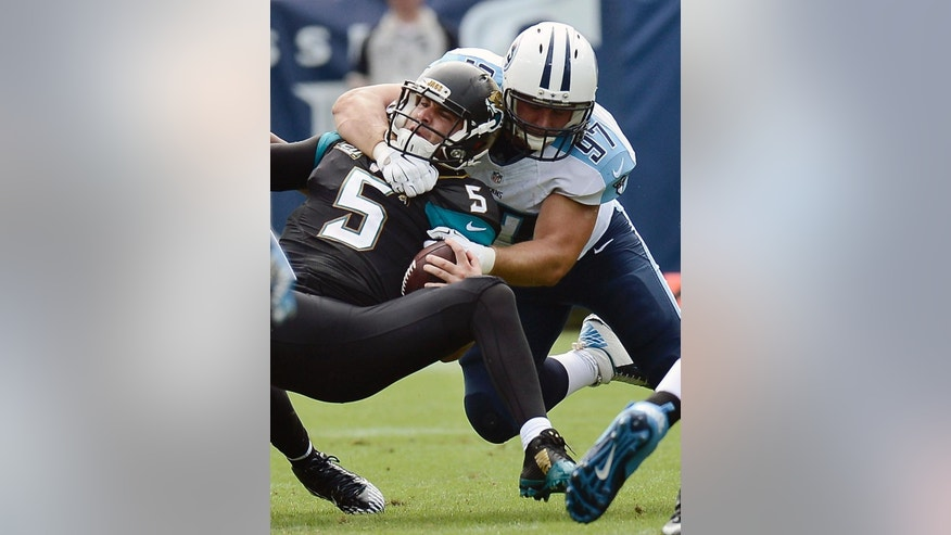 Tennessee Titans defensive end Jurrell Casey celebrates after sacking Jacksonville Jaguars quarterback Blake Bortles for a 9-yard loss in the second quarter of an NFL football game Sunday, Oct. 12, 2014, in Nashville, Tenn. (AP Photo/Mark Zaleski)