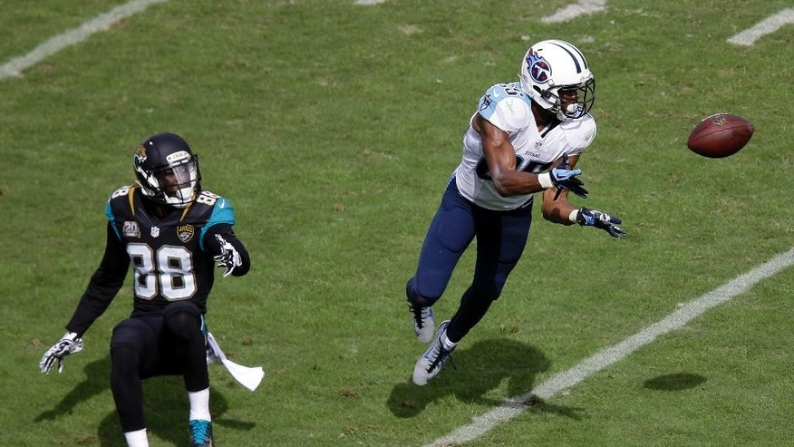 Tennessee Titans cornerback Blidi Wreh-Wilson (25) intercepts a pass intended for Jacksonville Jaguars wide receiver Allen Hurns (88) in the third quarter of an NFL football game Sunday, Oct. 12, 2014, in Nashville, Tenn. (AP Photo/Wade Payne)