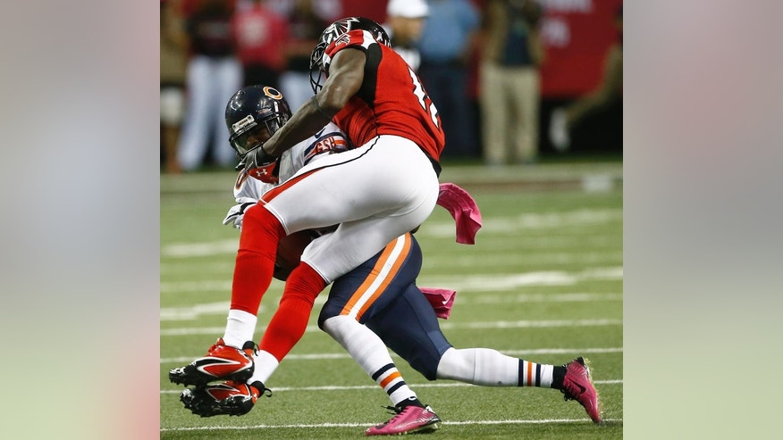 Chicago Bears cornerback Demontre Hurst (30) intercepts the ball from intended receiver Atlanta Falcons wide receiver Julio Jones (11) during the second half of an NFL football game, Sunday, Oct. 12, 2014, in Atlanta. (AP Photo/John Bazemore)