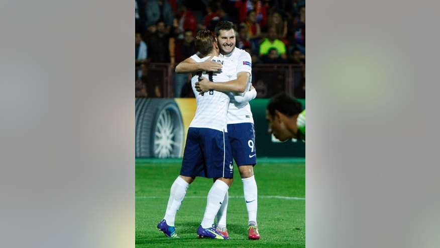 France's Antoine Griezmann, left, celebrates scoring with teammate Andre-Pierre Gignac during a friendly soccer match between Armenia and France in Yerevan, Armenia, Tuesday Oct. 14, 2014. (AP Photo/Hrant Khachatryan, PAN Photo)