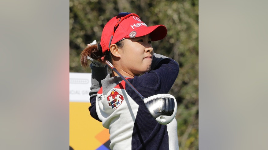 Haeji Kang of South Korea watches her shot on the 18th hole during the first round of the LPGA KEB Hana Bank Championship golf tournament at Sky72 Golf Club in Incheon, South Korea, Thursday, Oct. 16, 2014. (AP Photo/Ahn Young-joon)
