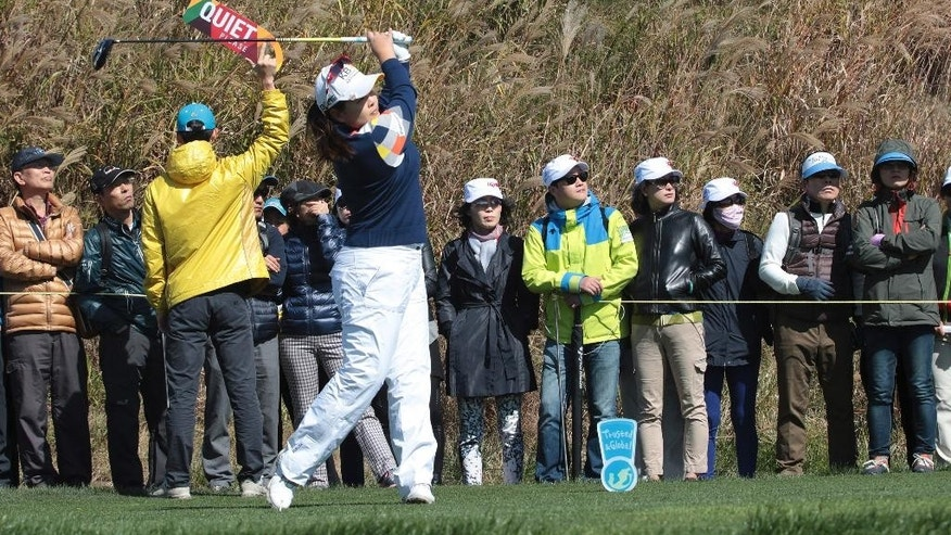 Inbee Park of South Korea watches her shot on the 7th hole during the first round of the LPGA KEB Hana Bank Championship golf tournament at Sky72 Golf Club in Incheon,, South Korea, Thursday, Oct. 16, 2014. (AP Photo/Ahn Young-joon)