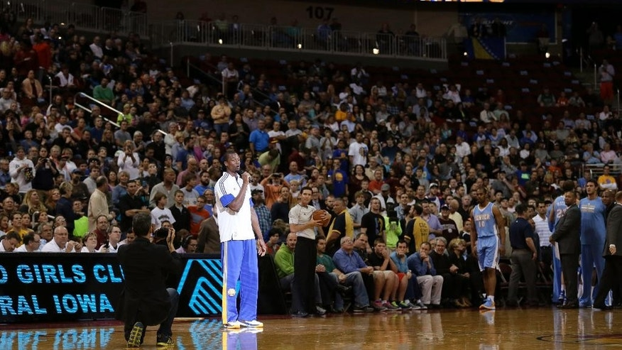Golden State Warriors forward Harrison Barnes addresses the crowd before the Warriors' preseason NBA basketball game against the Denver Nuggets, Thursday, Oct. 16, 2014, in Des Moines, Iowa. Barnes attended high school in nearby Ames, Iowa. (AP Photo/Charlie Neibergall)