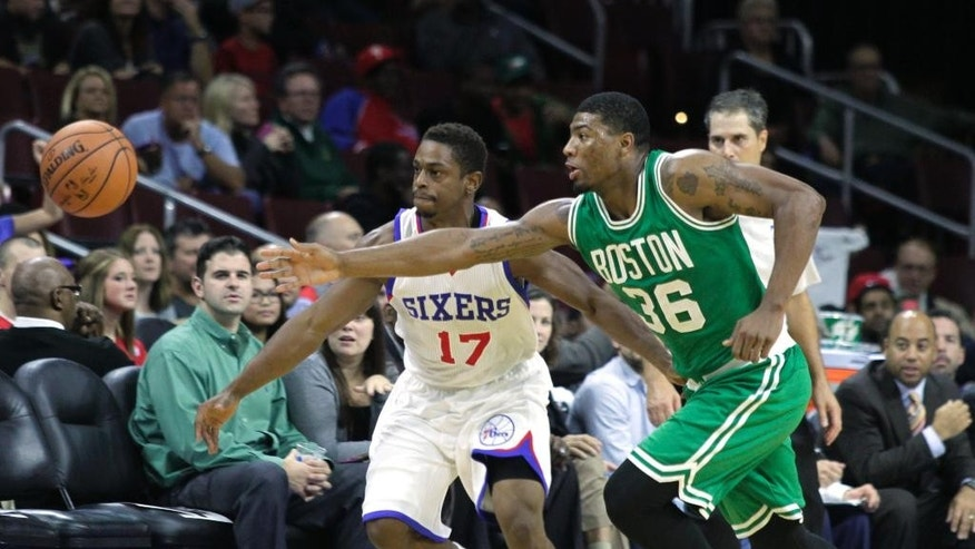 Boston Celtics' Marcus Smart (36) and Philadelphia 76ers' Casper Ware (17) chase a loose ball in the first half of a preseason NBA basketball game Thursday, Oct. 16, 2014, in Philadelphia. (AP Photo/H. Rumph Jr)
