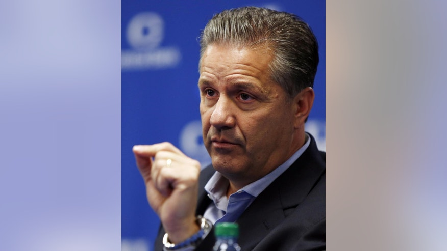 Kentucky head coach John Calipari speaks to reporters during the team's NCAA college basketball media day, Thursday, Oct. 16, 2014, in Lexington, Ky. (AP Photo/James Crisp)