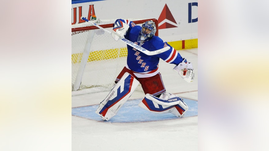 New York Rangers goalie Henrik Lundqvist, of Sweden, celebrates after the shootout in an NHL hockey game against the Carolina Hurricanes on Thursday, Oct. 16, 2014, in New York. The Rangers won 2-1. (AP Photo/Frank Franklin II)