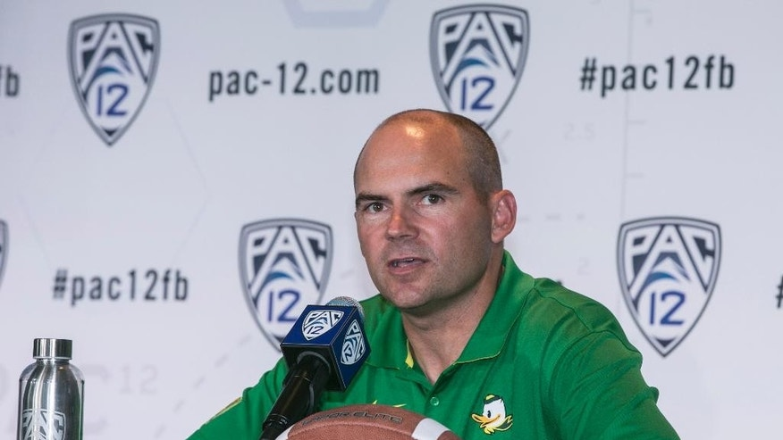 FILE - In this July 23, 2014, file photo, Oregon head coach Mark Helfrich takes questions at the  Pac-12 NCAA college football media days at Paramount Studios in Los Angeles. Don't write the Pac-12 off just yet. Oregon is still ranked in the top 10 and the way college football has gone this season, there's a good chance a one-loss team will get into the playoff. (AP Photo, File)