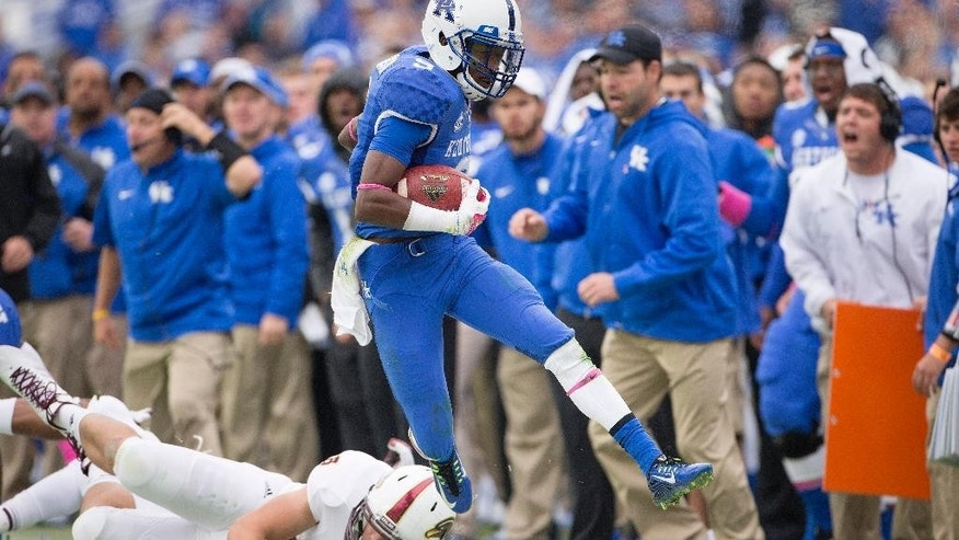 Kentucky wide receiver Javess Blue gets pushed out of bounds by Louisiana Monroe tight end Harley Scioneaux on a punt return during the second half of an NCAA college football game in Lexington, Ky., Saturday, Oct. 11, 2014. Kentucky won the game 48-14. (AP Photo/David Stephenson)