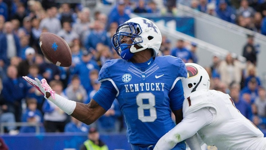 Kentucky wide receiver Javess Blue makes a one-handed touchdown catch over Louisiana Monroe cornerback Rob'Donovan Lewis during the second half of the of an NCAA college football game at Commonwealth Stadium in Lexington, Ky., Saturday, Oct. 11, 2014. Kentucky won the game 48-14.  (AP Photo/David Stephenson)