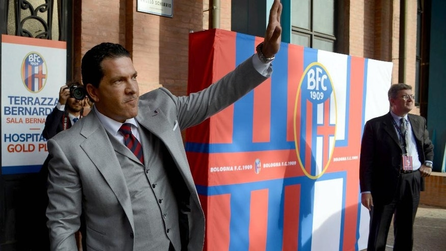 Joe Tacopina waves as he arrives for a news conference in Bologna, Italy, Thursday, Oct. 16, 2014. A group of North Americans led by New York lawyer Joe Tacopina were presented Thursday as the new owners of Italy's cash-strapped Serie B soccer club Bologna. Tacopina was named club president and Montreal Impact president Joey Saputo is a large investor. Tacopina, who represents New York Yankees slugger Alex Rodriguez in his drug case, resigned from his position on Roma's board to pursue the Bologna deal. (AP Photo/Gianfilippo Oggioni)
