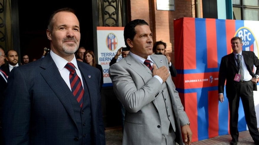 Joey Saputo, left, and Joe Tacopina arrive for a news conference in Bologna, Italy, Thursday, Oct. 16, 2014. A group of North Americans led by New York lawyer Joe Tacopina were presented Thursday as the new owners of Italy's cash-strapped Serie B soccer club Bologna. Tacopina was named club president and Montreal Impact president Joey Saputo is a large investor. Tacopina, who represents New York Yankees slugger Alex Rodriguez in his drug case, resigned from his position on Roma's board to pursue the Bologna deal. (AP Photo/Gianfilippo Oggioni)