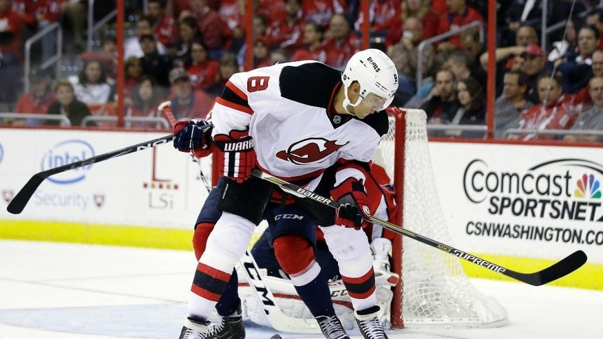 New Jersey Devils right wing Dainius Zubrus (8), from Lithuania, works the puck in front of the net in the second period of an NHL hockey game against the Washington Capitals, Thursday, Oct. 16, 2014, in Washington. (AP Photo/Alex Brandon)