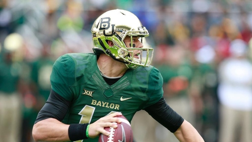 Baylor quarterback Bryce Petty (14) looks downfield against TCU in the first half of their NCAA college football game, Saturday, Oct. 11, 2014, in Waco, Texas. (AP Photo/Waco Tribune Herald, Jose Yau)