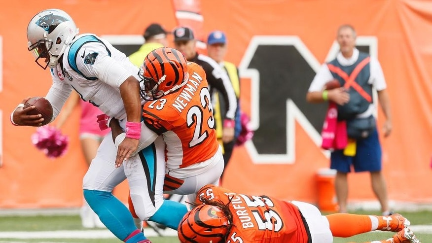 Carolina Panthers wide receiver Kelvin Benjamin (13) catches a touchdown pass against Cincinnati Bengals strong safety George Iloka in the first half of an NFL football game, Sunday, Oct. 12, 2014, in Cincinnati. (AP Photo/AJ Mast)