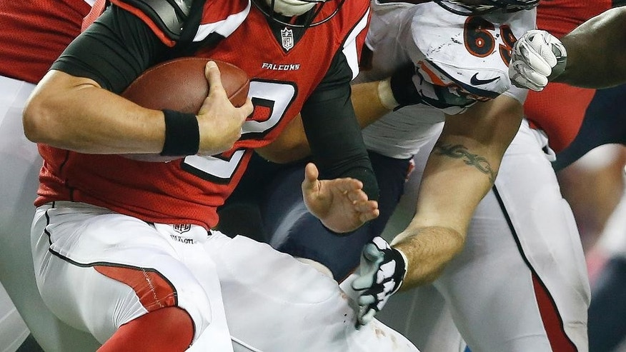 Atlanta Falcons quarterback Matt Ryan (2) is sacked by Chicago Bears defensive end Jared Allen (69) during the second half of an NFL football game, Sunday, Oct. 12, 2014, in Atlanta. The Chicago Bears won 27-13. (AP Photo/Brynn Anderson)