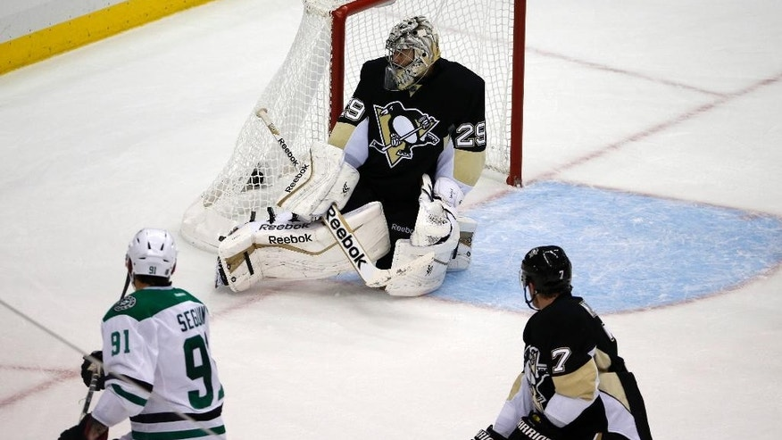 Dallas Stars' Tyler Seguin (91) puts the game-winning goal behind Pittsburgh Penguins goalie Marc-Andre Fleury (29) in the final seconds of an NHL hockey game in Pittsburgh, Thursday, Oct. 16, 2014. The Stars won 3-2. (AP Photo/Gene J. Puskar)