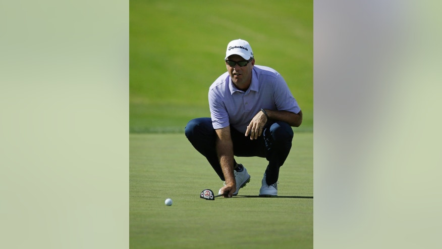 Stewart Cink lines up a put on the 17th green during the first round of the Shriners Hospitals for Children Open golf tournament Thursday, Oct. 16, 2014, in Las Vegas. (AP Photo/John Locher)