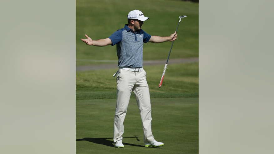 Martin Laird reacts after sinking a birdie putt on the 18th green during the first round of the Shriners Hospitals for Children Open golf tournament Thursday, Oct. 16, 2014, in Las Vegas. (AP Photo/John Locher)