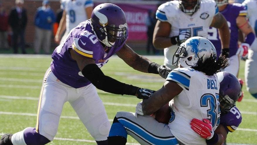 Minnesota Vikings defensive end Everson Griffen (97) and outside linebacker Gerald Hodges, left, stop Detroit Lions running back Joique Bell (35) after a 15-yard pass reception during the second half of an NFL football game Sunday, Oct. 12, 2014, in Minneapolis. (AP Photo/Ann Heisenfelt)