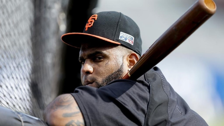 San Francisco Giants third baseman Pablo Sandoval watches during batting practice before Game 5 of the National League baseball championship series against the St. Louis Cardinals Thursday, Oct. 16, 2014, in San Francisco. (AP Photo/Ben Margot)