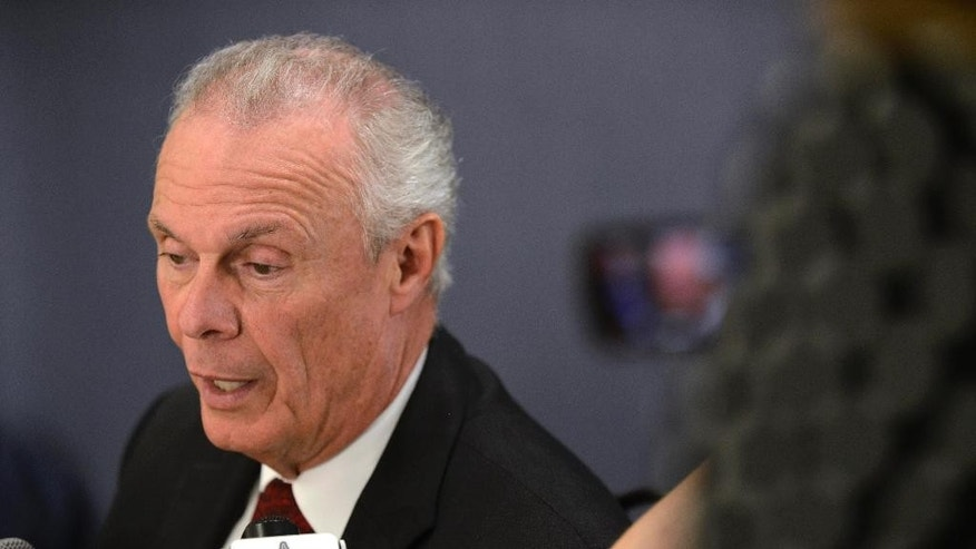 Wisconsin NCAA college basketball men's head coach Bo Ryan talks with the media during Big Ten media day in Rosemont, Ill., Thursday, Oct. 16, 2014. (AP Photo/Paul Beaty)