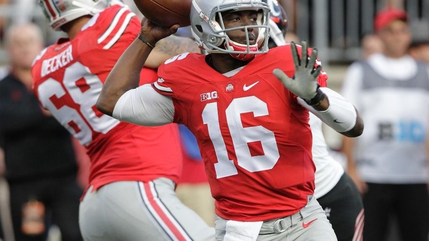 FILE - In this Sept. 27, 2014, file photo, Ohio State quarterback J.T. Barrett plays against Cincinnati during an NCAA college football game in Columbus, Ohio. Many were surprised when redshirt freshman Barrett was ordained in the preseason as the backup quarterback for Ohio State. Absolutely no one expected what happened when he stepped in when Braxton Miller was lost for the season with a shoulder injury.(AP Photo/Jay LaPrete)