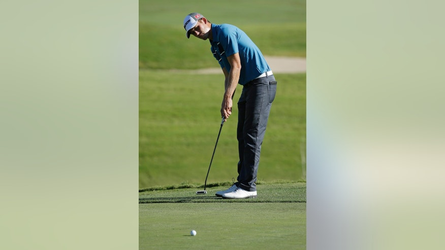 Andrew Putnam putts on the third green during the second round of the Shriners Hospitals for Children Open golf tournament Friday, Oct. 17, 2014, in Las Vegas. (AP Photo/John Locher)