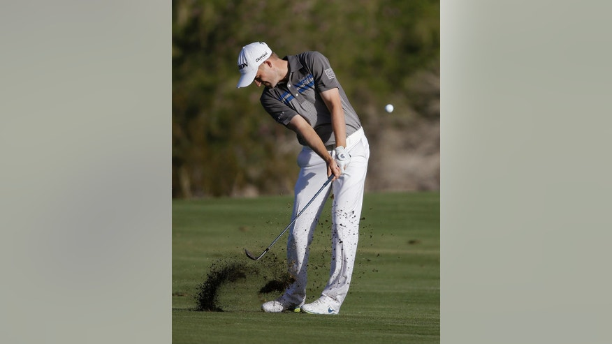 Russell Knox hits on to the 18th green during the second round of the Shriners Hospitals for Children Open golf tournament Friday, Oct. 17, 2014, in Las Vegas. (AP Photo/John Locher)