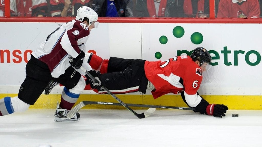 Ottawa Senators' Bobby Ryan (6) gets tangled up with Colorado Avalanche's Matt Duchene (9) during the second period of an NHL hockey game Thursday, Oct. 16, 2014, in Ottawa, Ontario. (AP Photo/The Canadian Press, Justin Tang)