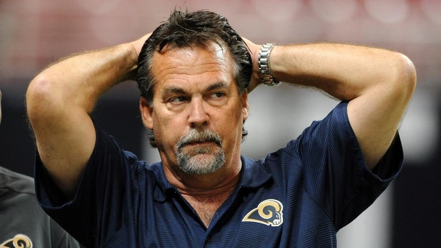 FILE - In this Aug. 29, 2013, file photo, St. Louis Rams head coach Jeff Fisher looks on before the start of a preseason NFL football game between the Rams and the Baltimore Ravens in St. Louis. The Rams have squandered nice cushions their last two home games, the latest against the 49ers on Monday night, Oct. 13, 2014. Year 3 under coach Fisher thus far has been a bust.  (AP Photo/Bill Boyce, File)