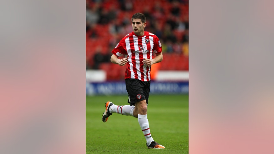 FILE - In this March 17, 2012 file photo, Sheffield United's Ched Evans runs on the pitch during a soccer match in Sheffield, England. Evans, a former Premier League footballer who was convicted of rape was released from jail on Friday, Oct. 17, 2014 amid a national debate about whether he should be allowed to play professionally again. (AP Photo/PA, Nick Potts, File) UNITED KINGDOM OUT, NO SALES, NO ARCHIVE