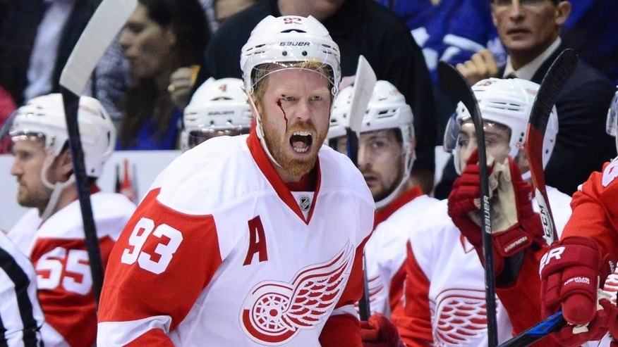 Detroit Red Wings' Detroit Red Wings' Johan Franzen yells at the referee after taking a hit to the head against the Toronto Maple Leafs during first-period NHL hockey game action in Toronto, Friday, Oct. 17, 2014. (AP Photo/The Canadian Press, Frank Gunn)