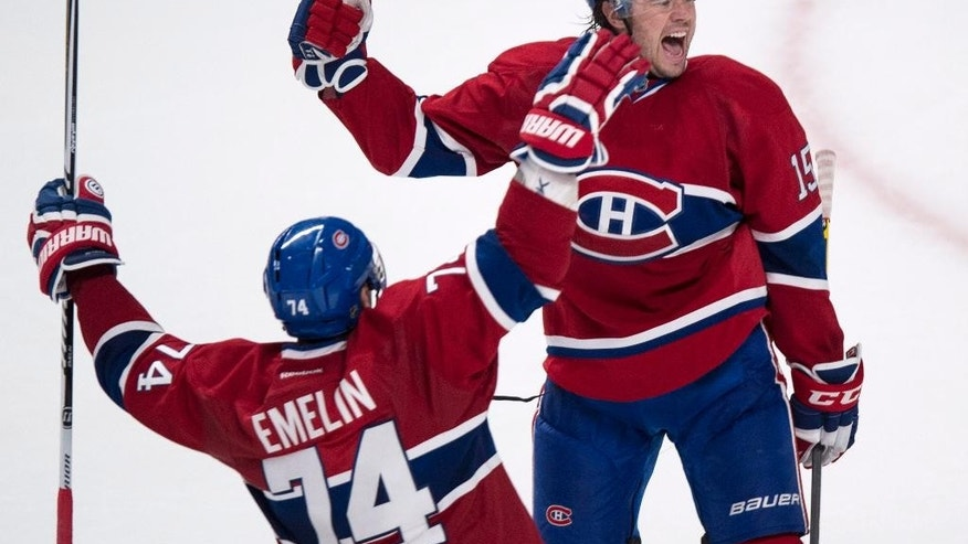 Montreal Canadiens' P.A. Parenteau, right, celebrates his goal against the Boston Bruins with teammate Alexei Emelin during second-period NHL hockey game action Thursday, Oct. 16, 2014, in Montreal. (AP Photo/The Canadian Press, Paul Chiasson)