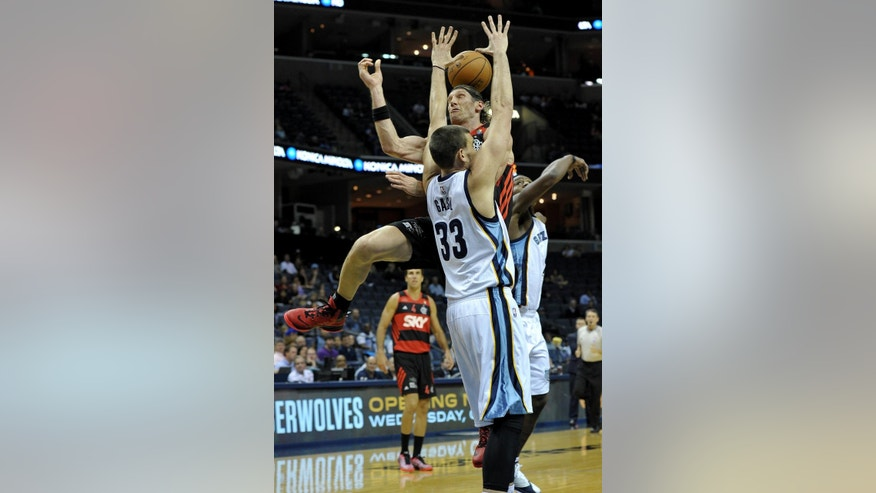 Flamengo forward Walter Herrmann, top, misses a shot against Memphis Grizzlies center Marc Gasol (33) in the first half of a preseason NBA basketball game Friday, Oct. 17, 2014, in Memphis, Tenn. (AP Photo/Brandon Dill)