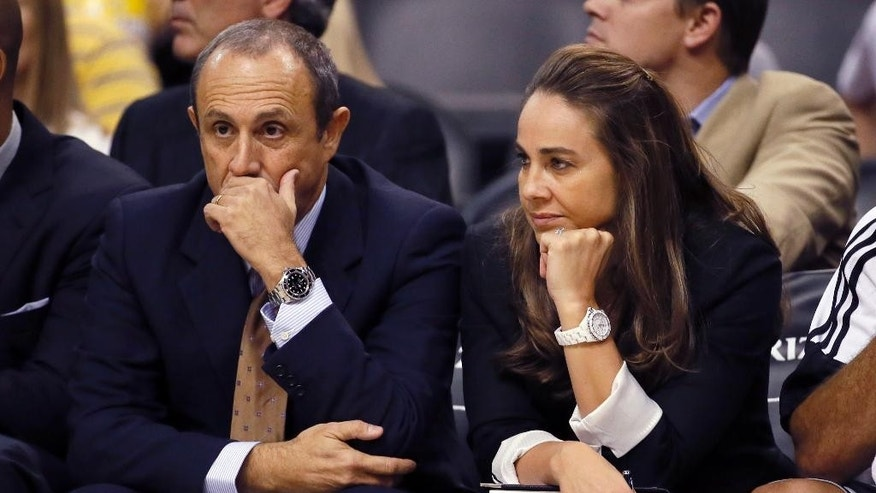 San Antonio Spurs assistant coaches Becky Hammon and Ettore Messina, of Italy, watch during the second half of the Spurs' NBA preseason basketball game against the Phoenix Suns, Thursday, Oct. 16, 2014, in Phoenix. (AP Photo/Matt York)
