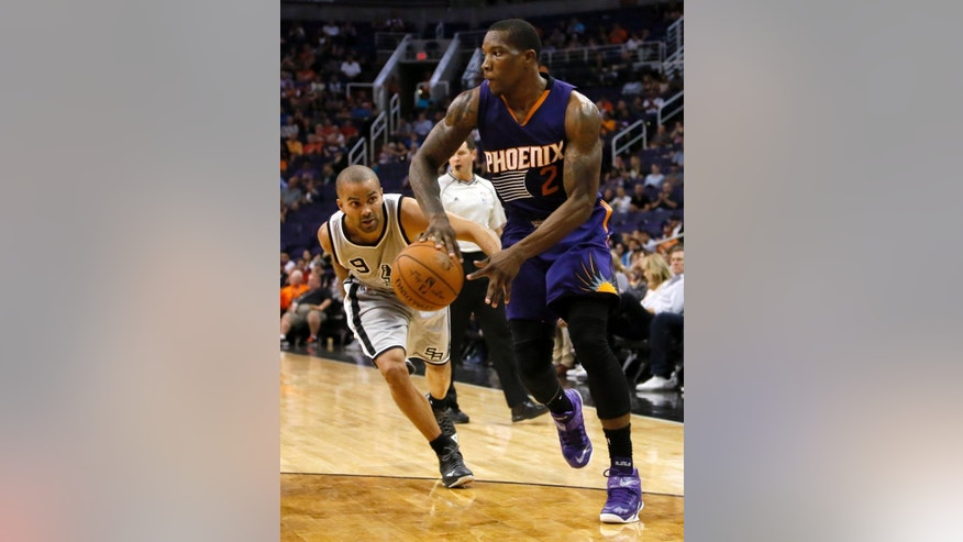 Phoenix Suns guard Eric Bledsoe (2) passes as San Antonio Spurs guard Tony Parker defends during the second half of an NBA preseason basketball game, Thursday, Oct. 16, 2014, in Phoenix. (AP Photo/Matt York)