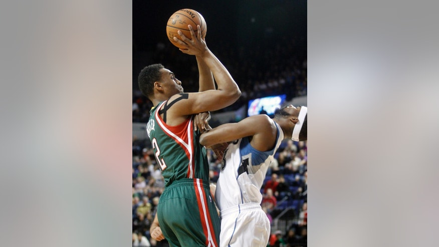 Milwaukee Bucks forward Jabari Parker, left, drives to the basket past Minnesota Timberwolves forward Corey Brewer during the first half of a preseason NBA basketball game, Friday, Oct. 17, 2014, in Cedar Rapids, Iowa. (AP Photo/Matthew Holst)
