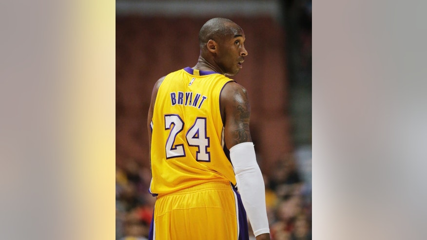 Los Angeles Lakers' Kobe Bryant walks down the court during the first half of a preseason NBA basketball game against the Utah Jazz on Thursday, Oct. 16, 2014, in Anaheim, Calif. (AP Photo/Jae C. Hong)