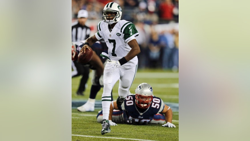 New York Jets quarterback Geno Smith (7) scrambles away from New England Patriots defensive end Rob Ninkovich (50) during the first half of an NFL football game Thursday, Oct. 16, 2014, in Foxborough, Mass. (AP Photo/Charles Krupa)