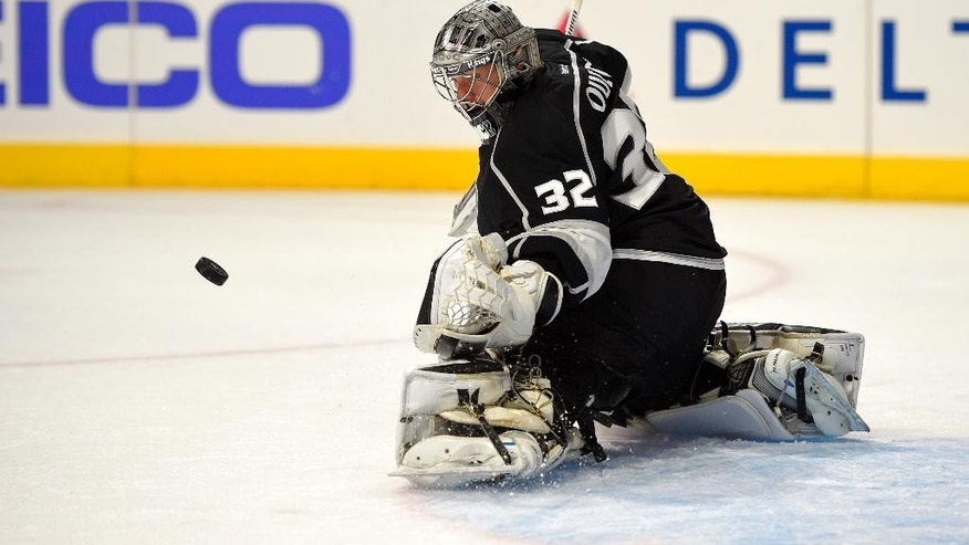 Los Angeles Kings goalie Jonathan Quick stops a shot during the first period of an NHL hockey game against the St. Louis Blues, Thursday, Oct. 16, 2014, in Los Angeles. (AP Photo/Mark J. Terrill)