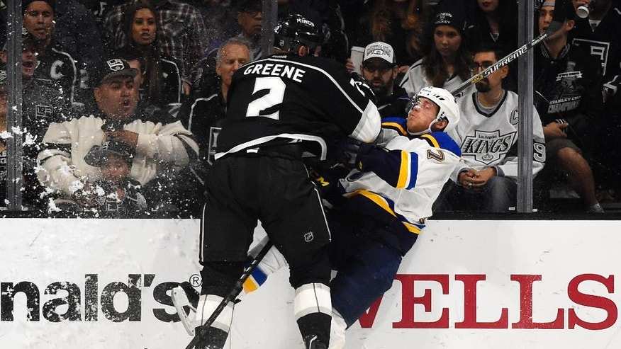 Los Angeles Kings defenseman Matt Greene, left, and St. Louis Blues left wing Jaden Schwartz collide during the second period of an NHL hockey game, Thursday, Oct. 16, 2014, in Los Angeles. (AP Photo/Mark J. Terrill)