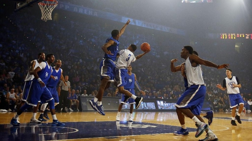 The Kentucky men's team scrimmages during their NCAA college basketball Big Blue Madness, Friday, Oct. 17, 2014, in Lexington, Ky. (AP Photo/James Crisp)