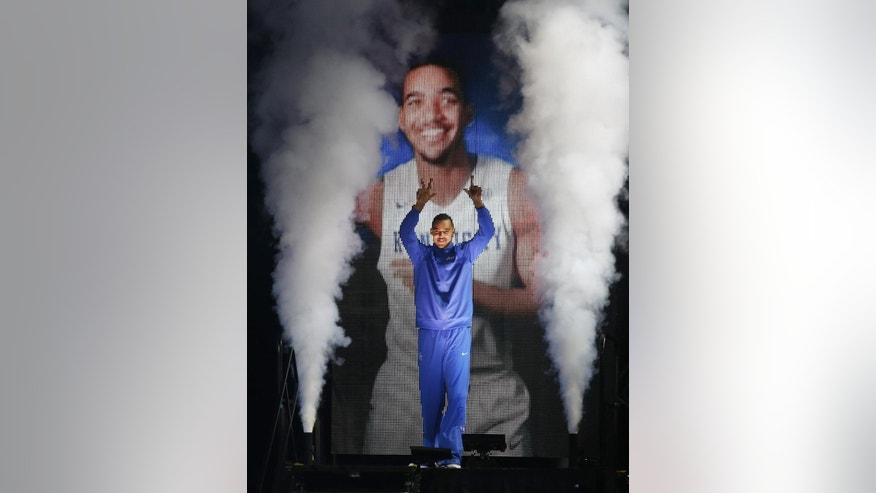 Kentucky's Trey Lyles is introduced during the team's NCAA college basketball Big Blue Madness, Friday, Oct. 17, 2014, in Lexington, Ky. (AP Photo/James Crisp)