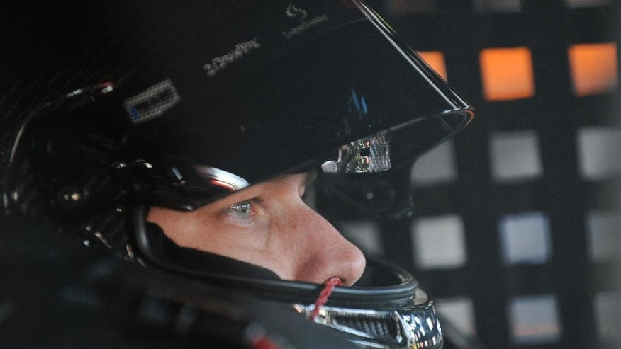 NASCAR driver Brad Keselowski sits in his car before practicing for Sunday's NASCAR Geico 500 Sprint Cup Series auto race at Talladega Superspeedway Friday, Oct. 17, 2014, in Talladega, Ala. (AP Photo/Rainier Ehrhardt)