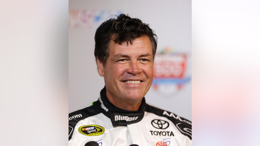 "FILE - In this Feb. 13, 2014, file photo, Michael Waltrip smiles during NASCAR auto racing media day at Daytona International Speedway in Daytona Beach, Fla. Michael Waltrip is gearing up for a weekend of driving and dancing at Talladega Superspeedway. He'll be practicing for Monday night's, Oct. 20, 2014, ""Dancing with the Stars"" appearance when he's not on the track. (AP Photo/John Raoux, File)"