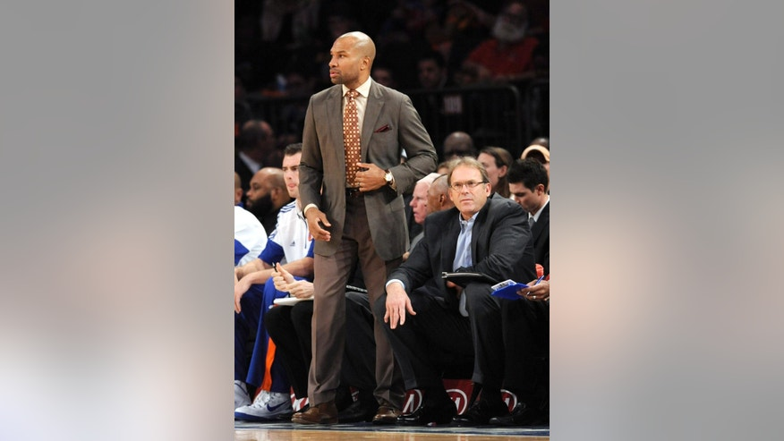 ADVANCE FOR WEEKEND EDITIONS, OCT. 18-19 - In this Oct. 13, 2014, photo, New York Knicks coach Derek Fisher watches the game as associate coach Kurt Rambis, right, looks on during the first quarter of an NBA basketball game against the Toronto Raptors  at Madison Square Garden in New York.For decades NBA assistant coaches have been the anonymous, but critical, parts of an NBA coaching staff. The head coaches get all the credit, and the blame, for the successes and failures of the team. But as an influx of head jobs are filled with men who have little to no NBA coaching experience, assistants like Ron Adams, Kurt Rambis and Tyronn Lue are rising in stature and finally shining a light on the grinders behind the scenes.   (AP Photo/Bill Kostroun)